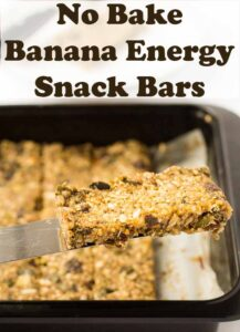 A no bake banana energy bar being lifted out of the baking tray on a spatula. Pin title text overlay at top.