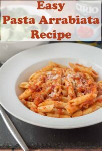 A bowl of easy pasta arrabiata garnished with grated parmesan and a fork beside. Pin title text overlay at top.