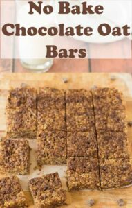 No bake chocolate oatmeal bars carved into 16 squares on a chopping board. Pin title text overlay at top.