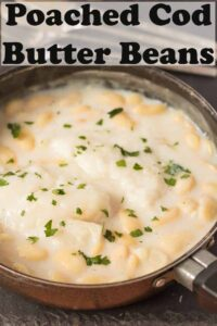 Poached cod with butter beans cooking in a shallow pan. Pin title text overlay at top.