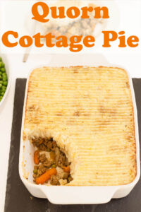 Vegetarian quorn cottage pie served with a portion taken out.