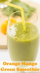 A glass of orange mango green smoothie with a straw in. Pin title text overlay at bottom.