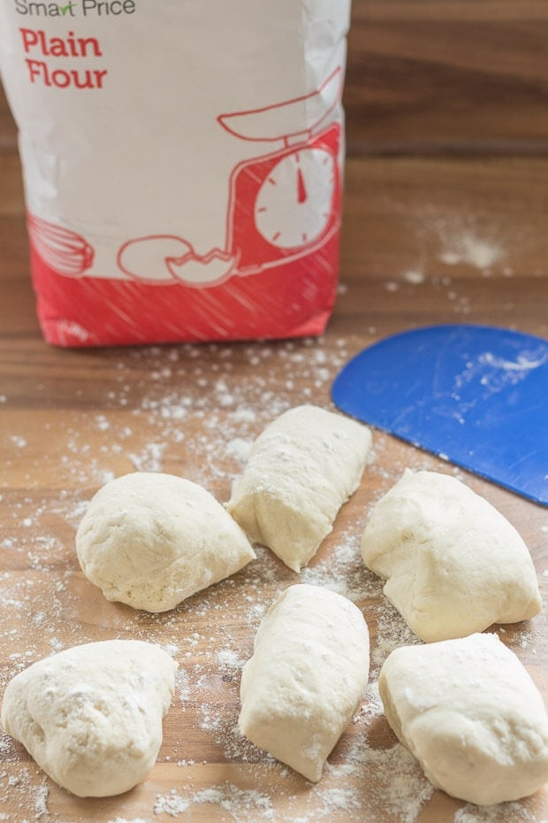 Cut the home made naan bread dough up into 6 pieces.