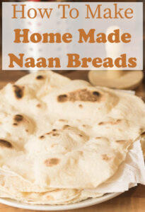 Home Made Naan Breads in a pile on a plate.