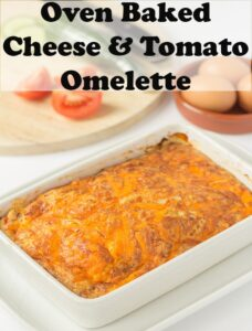 Oven baked cheese and tomato omelette just removed from oven. Pin title text overlay at top.