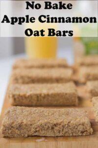 No bake apple cinnamon oat bars on a chopping baord. Pin title text overlay at top.