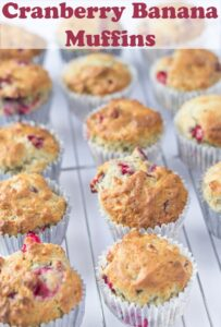 A wire rack with cranberry banana muffins on. Pin title text overlay at top.