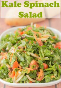 A serving dish of kale spinach salad. Pin title text overlay at top.