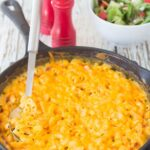 Skillet baked macaroni and cheese. The delicious classic comfort food easily made into a quick healthy meal for 4 in just one pan