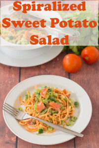 Two plates of spiralized sweet potato salad on two plates one in front of another.