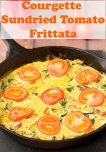 Cooked in a pan courgette and sundried tomato frittata.