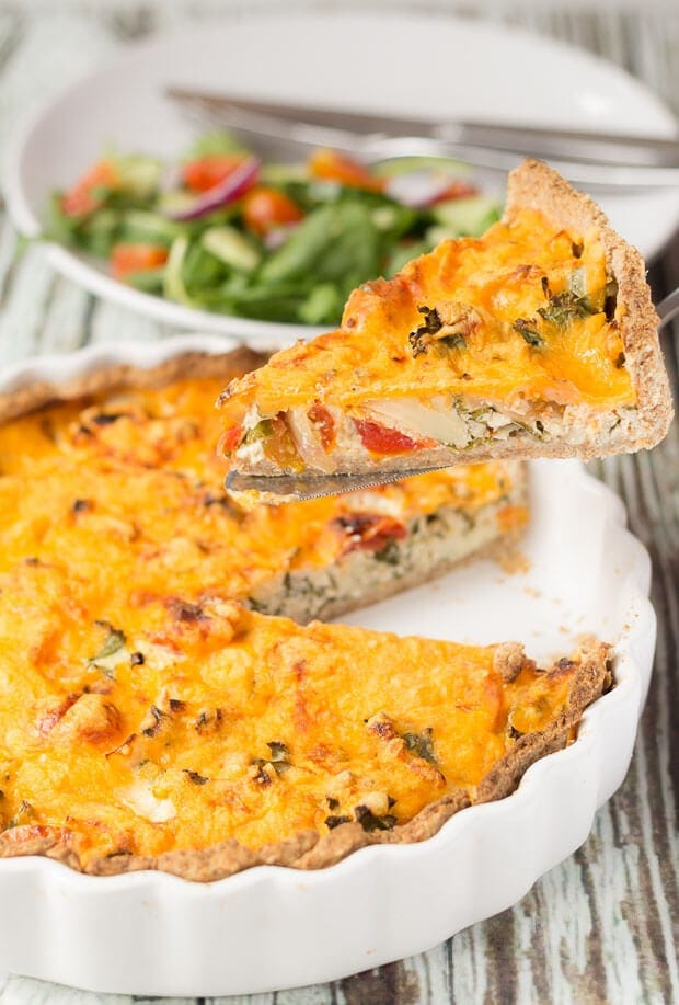 This cheesy tomato and kale quiche recipe makes 8 tasty slices. It's ideal for lunch boxes and also a quick and easy dinner, perfect served with a salad.
