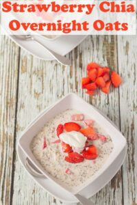 Birds eye view of two bowls of strawberry chia overnight oats.