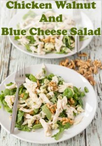 Two plates of chicken walnut and blue cheese salad one in front of the other.