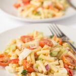 This healthy macaroni salad recipe has all the flavours and creaminess that you would expect from the classic salad but made with a lower calorie dressing.