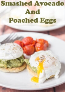 Two plates of smashed avocado and poached eggs on muffins one in front of another. With burst yolks.