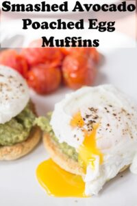A plate of smashed avocado poached eggs on muffins with cherry tomatoes. Pin title text overlay at top.