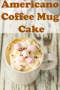 Americano coffee mug cake topped with mini marshmallows. Pin title text overlay at top.