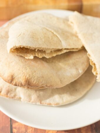 Homemade whole grain pita bread is a healthier version of the classic pocket bread. A staple of the Middle East this is an easy recipe that everyone can make at home. Delicious with hummus or stuffed with your favourite filling!