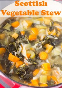 Birds eye view of a casserole pot of Scottish vegetable stew. Pin title text overlay at top.