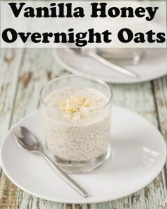 Vanilla honey overnight oats in a glass on a white plate with a teaspoon ready to eat.