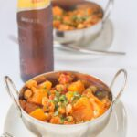 Chickpea and butternut squash curry is a delicious quick healthy curry. This simple vegan curry is not only minimum fuss to make but it costs less too. It's perfect for mid week dinners or a weekend supper!