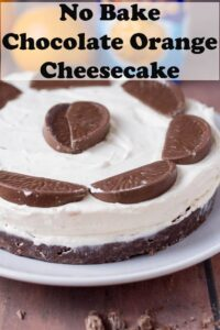 No bake Terrys chocolate orange cheesecake dessert decorated with chocolate orange segments and ready to serve.