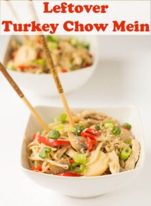 Two bowls of turkey chow mein one in front of the other with chopsticks in.