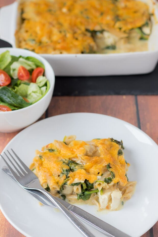 Easy chicken spinach pasta bake is a delicious family pasta bake. Made with a healthier low fat cheese sauce this quick healthy all in one meal can be on the table in less than an hour. Plus hiding the spinach is a perfect way to get kids to eat it!