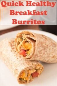 Close up of a plates with two quick healthy breakfast burritos stacked on it. Pin title text overlay at top.