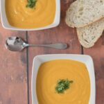 Roasted parsnip and carrot soup is a delicious blend of budget vegetables which combine to produce an amazingly tasty, creamy and gluten free vegan soup. Easy to make and healthy this simple soup is a fantastic winter warmer!