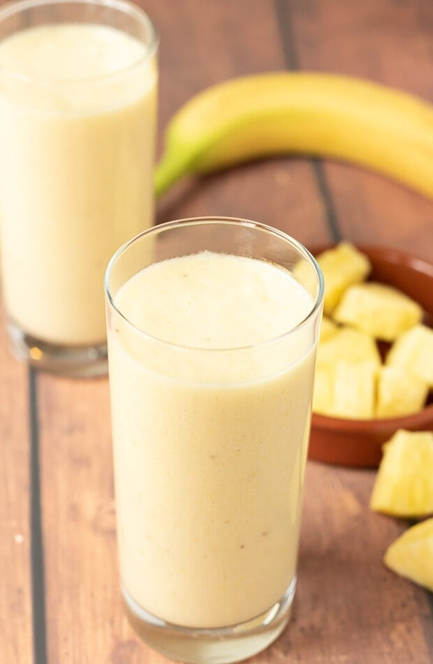 4-ingredient tropical banana smoothie not only tastes amazing but takes just five minutes to make. With a delicious creamy texture it's not only refreshing but also revitalising and rejuvenating. Start your day with a ray of sunshine with this healthy banana smoothie recipe!