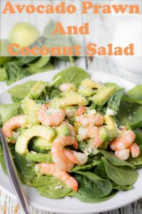 A plate of avocado prawn and coconut salad with a fork on the side.