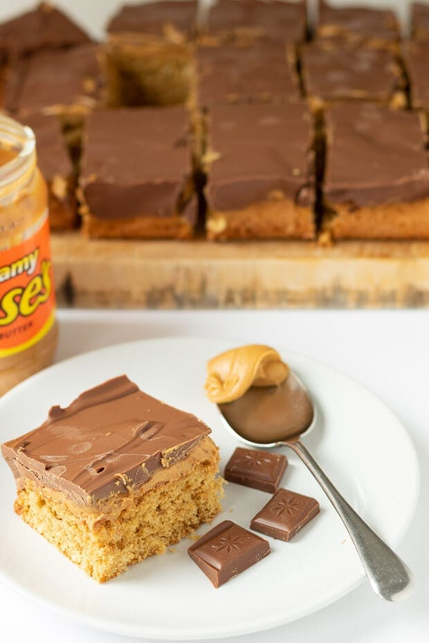 Chocolate peanut butter tray bake is a fantastic recipe to serve up at parties or as a special treat. The sponge cake is baked, covered in delicious peanut butter and then smothered in smooth milk chocolate. This is one of the best chocolate tray bakes you will ever try!