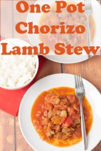 Two plates of chorizo and lamb stew with forks to the side. A bowl of rice at the left hand side. Pin title text overlay at top.