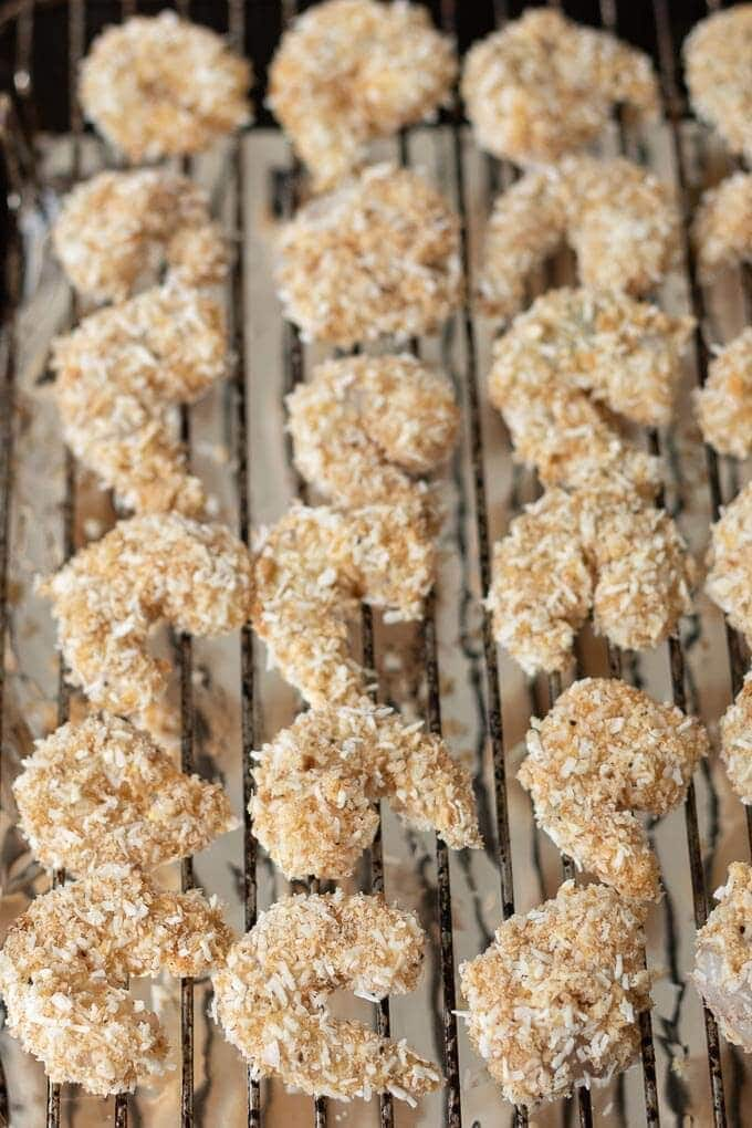 healthy baked coconut prawns on grill pan before baking