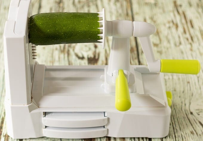 How to make courgette spaghetti spiralizer picture with courgette placed in it.