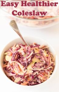 A bowl of easy healthy coleslaw with a serving spoon in.