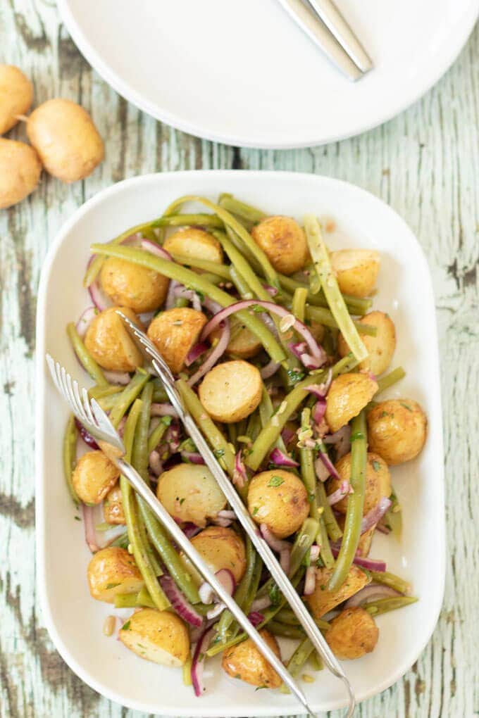 Roast potato and green bean salad is a simple and delicious salad. It can be served warm or as a side to go with your favourite main dish. It's also a great way of using up any leftover roast potatoes. It makes a great flavoursome packed lunch too!