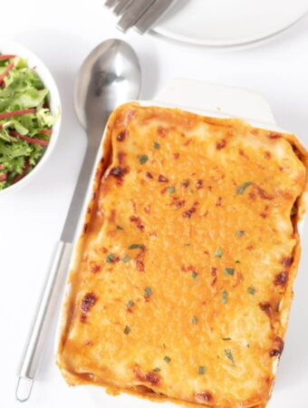 Easy homemade quorn lasagne cooked and displayed on a table ready to be cut and served.