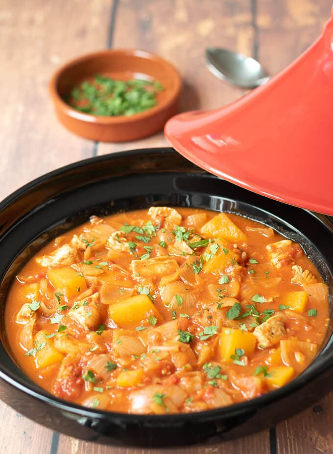 Moroccan chicken tagine dinner cooked in tagine dish ready to serve.