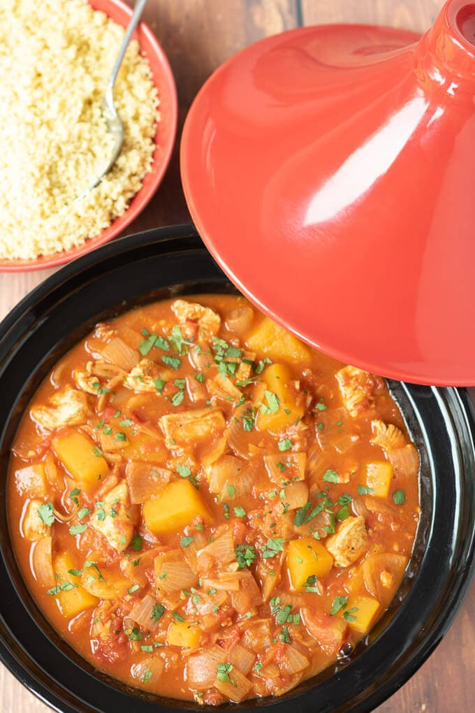 Moroccan chicken tagine dinner cooked in tagine dish ready to serve with couscous.