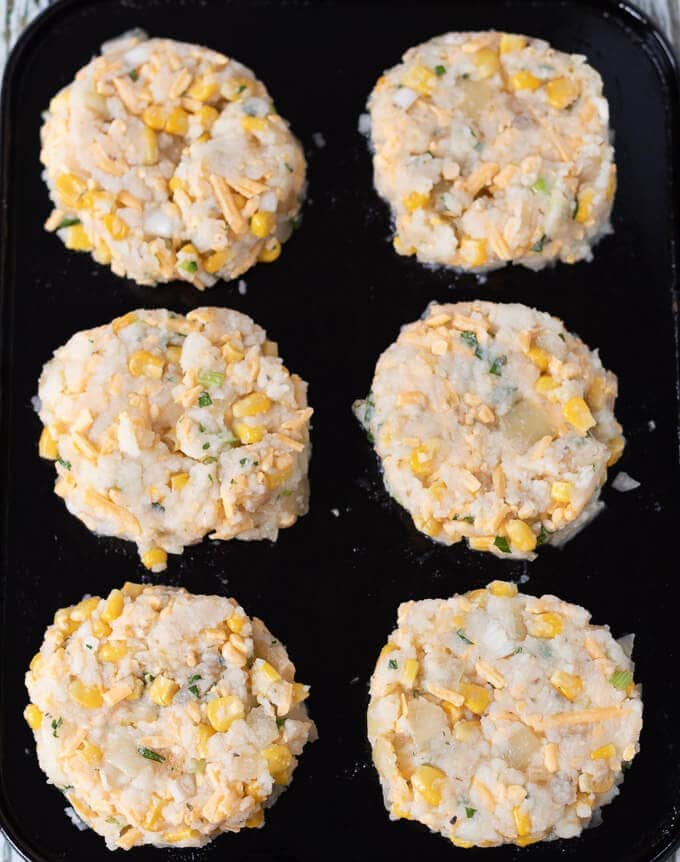 Leftover mashed potato cakes on a baking tray ready to go into the oven.