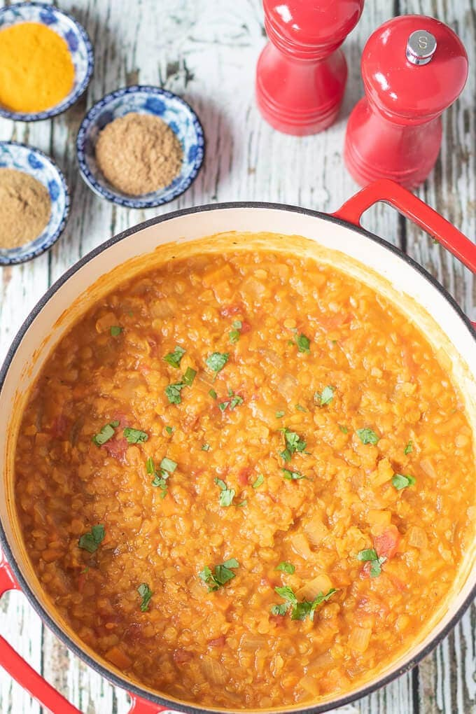 Moroccan lentil soup cooked in red casserole pot.