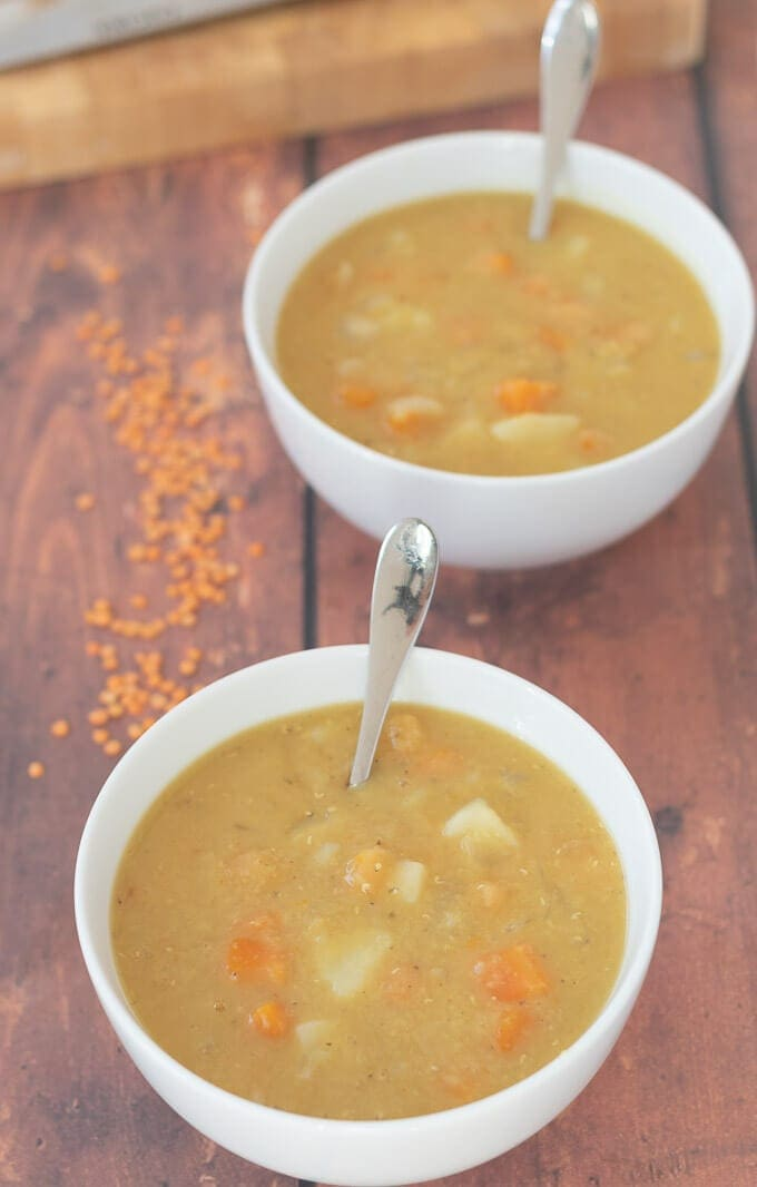 Two bowls of delicious easy Scottish lentil soup in a diagonal line.