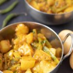 40 minute potato curry served in two balti curry dishes ready to eat.