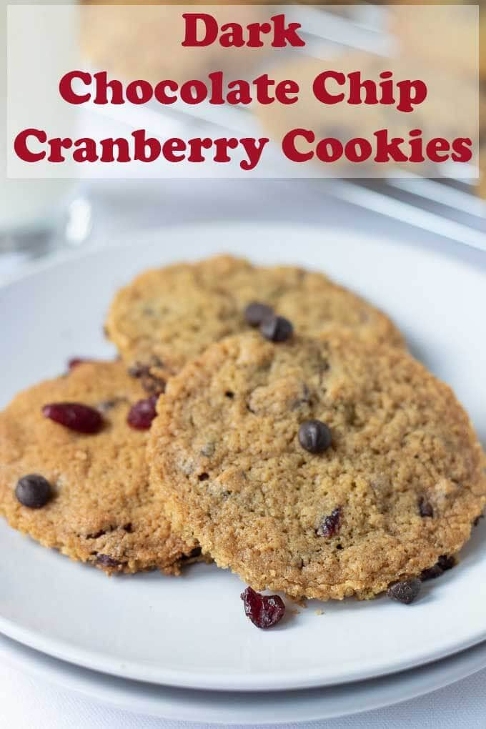 Dark chocolate chip cranberry cookies are delicious sweet soft and chewy holiday treats. Easy to make, the combination of melted dark chocolate chips and sweet cranberries is irresistible! #neilshealthymeals #recipe #dark #chocolate #cranberry #cookies #baking