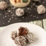 A plate of delicious mums no bake chocolate snowballs piled up and ready to eat!