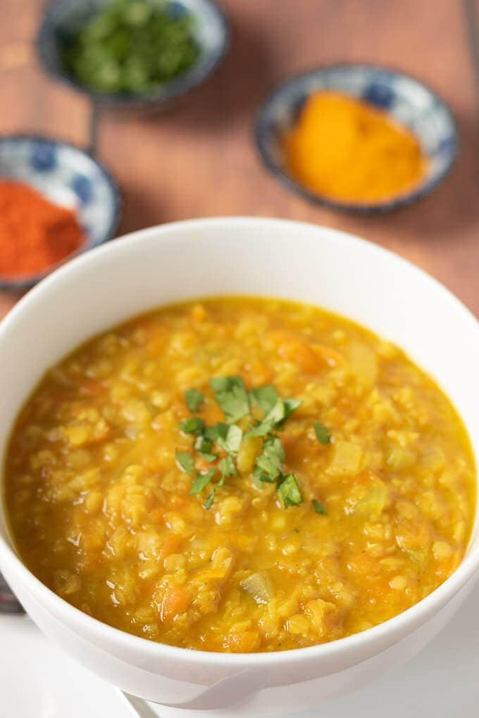 Closeup of bowl of currued red lentil soup. Looks delicious and ready to eat!