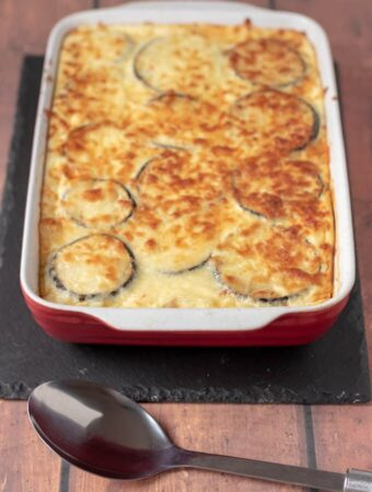 Delicious healthier Moussaka just taken out of the oven and cooling before being carved up and served.